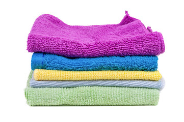 Stacked colorful towels on white background