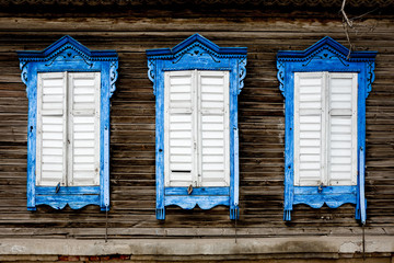Three old wooden window. Russian traditional style