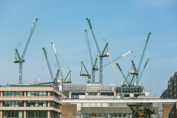 Cranes on a building site in London next to Thames
