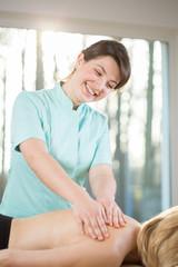 Smiling female masseur
