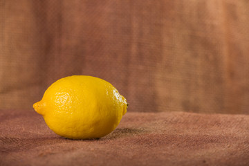Lemon. Fresh fruits. Lemon on a brown background.