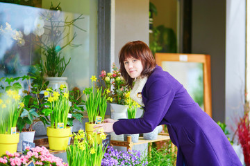 Girl selecting flowers in a Parisian flower shop