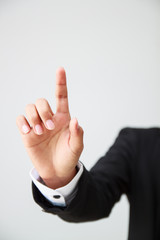 business man pointing finger for advertising or presentation