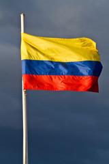 Flag of Ecuador over blue sky background