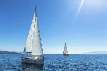 Sailing. Yachting. Ship yachts with white sails in the open sea.