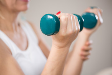 Elbow flexion with dumbbells