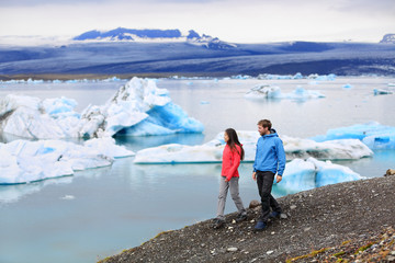 People hiking Iceland Jokulsarlon glacial lagoon