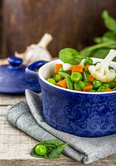 Assorted vegetables with spinach leaves