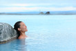 Geothermal spa - woman relaxing in hot spring pool