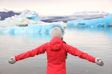 Freedom happy woman at glacier lagoon on Iceland