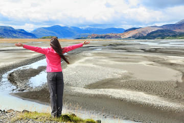 Woman enjoying view of Iceland black sand dunes