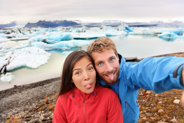 Funny selfie couple having fun on Iceland