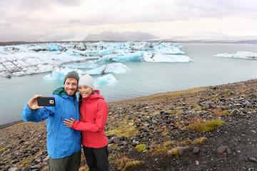 Travel couple taking selfie self portrait Iceland