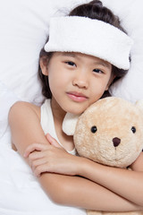 Little Asian child has fever and laying on the bed, get well
