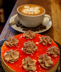 red cake with coffee cup in wooden table