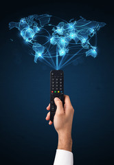 Hand with remote control, social media concept