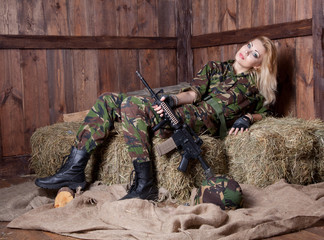 Military woman lying on straw