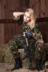 Military women with a weapon