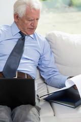 Senior businessman looking at notes