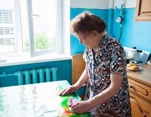Elderly woman on the kitchen