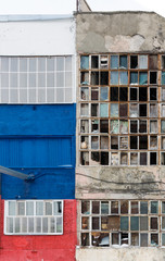 background of old broken windows. Russian flag on the wall