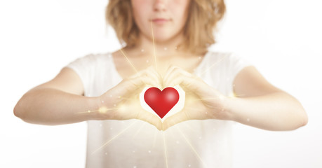 Hands creating a form with shining heart