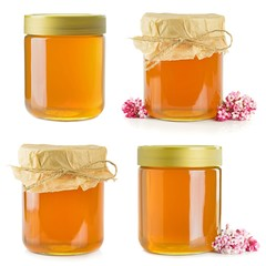 A selection of jars of honey isolated on a white background