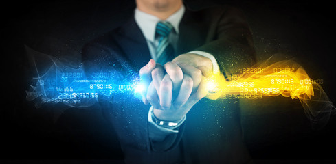 Man holding colorful glowing data in his hands