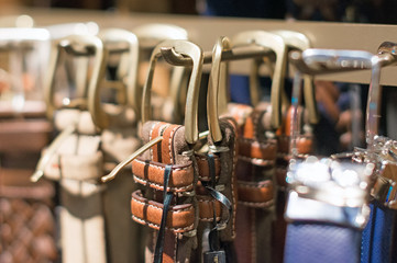 Leather belts collection in the store.