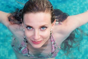 Sexy woman swimming in pool