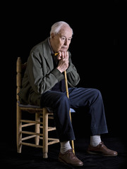 Elderly man sitting in a chair
