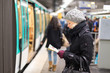 Lady waiting on subway station platform. - 79779321