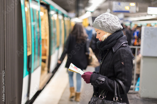 Lady waiting on subway station platform. - 79779321