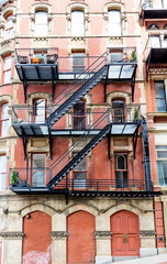Black Wrought Iron Fire Escape on Old Brick Building