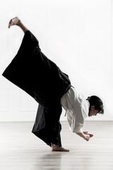 beautiful woman wearing a hakama engaged in Jiu Jitsu 7