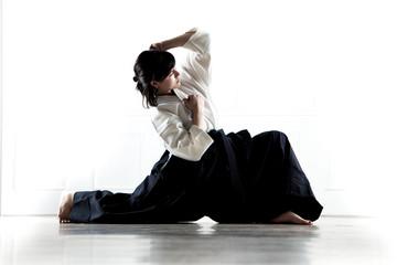 beautiful woman wearing a hakama engaged in Jiu Jitsu 6