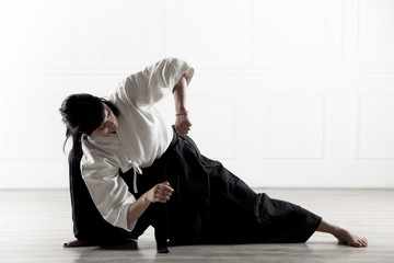 beautiful woman wearing a hakama engaged in Jiu Jitsu 5