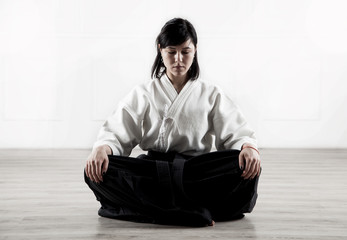 beautiful, young woman meditating in a sports hall 1