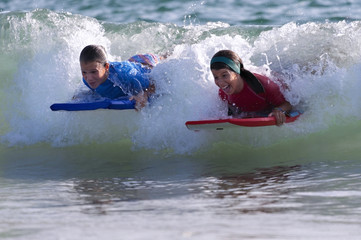 Two Girls doing surf in the beach