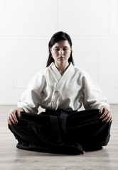 beautiful, young woman meditating in a sports hall 2