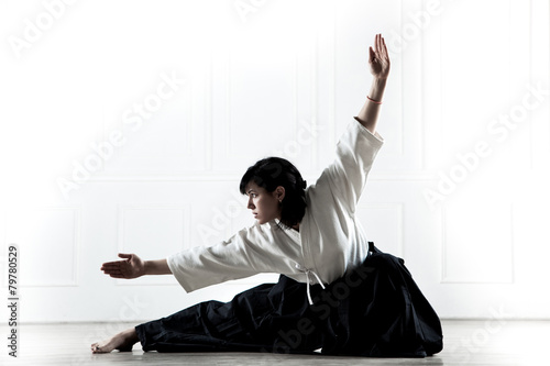 beautiful woman wearing a hakama engaged in kung Fu 1 - 79780529