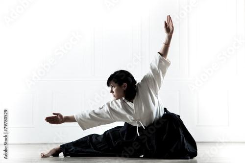 beautiful woman wearing a hakama engaged in kung Fu 1 - 79780529