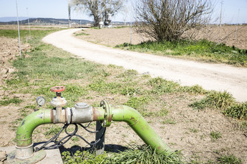 plumbing of an automatic irrigation system and a country road