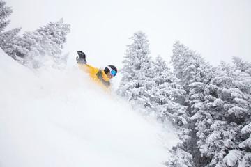 Freeride snowboarder on ski slope