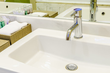 White sink and faucet in a bathroom