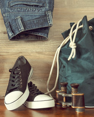 Shoes, backpack, jeans and  binoculars