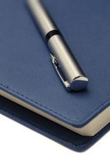 macro ballpoint pen on agenda