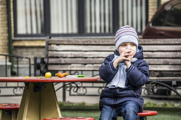 boy intently watching the playground