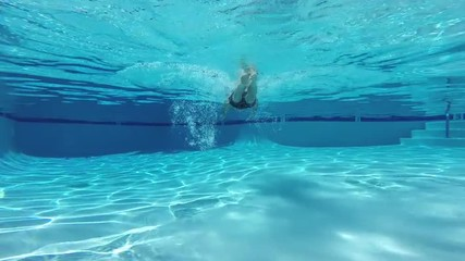 Man Swimming in Clean Pool