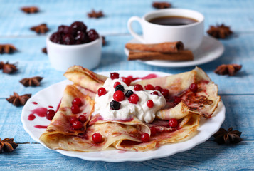 Breakfast pancakes with cherry jam